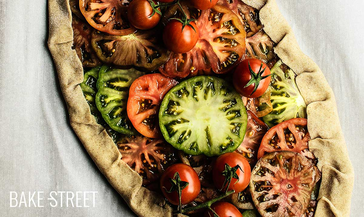 Rye galette with pesto and tomatoes